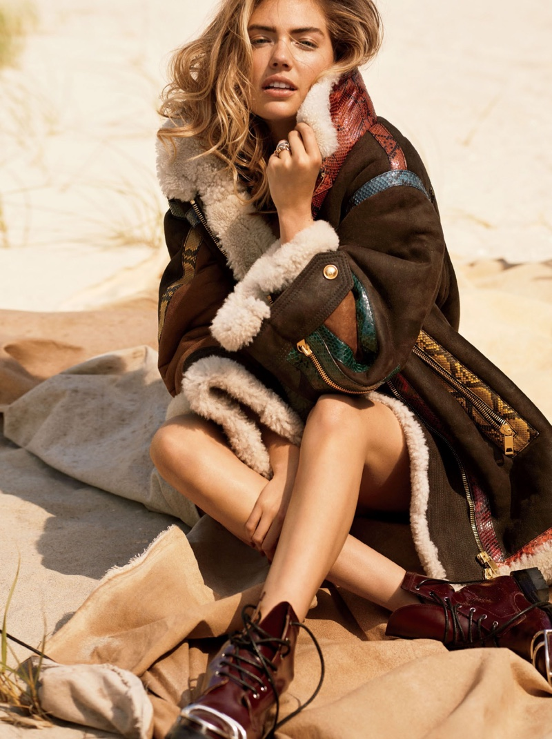 Kate Upton covers up in Burberry coat with Alexander Wang combat boots