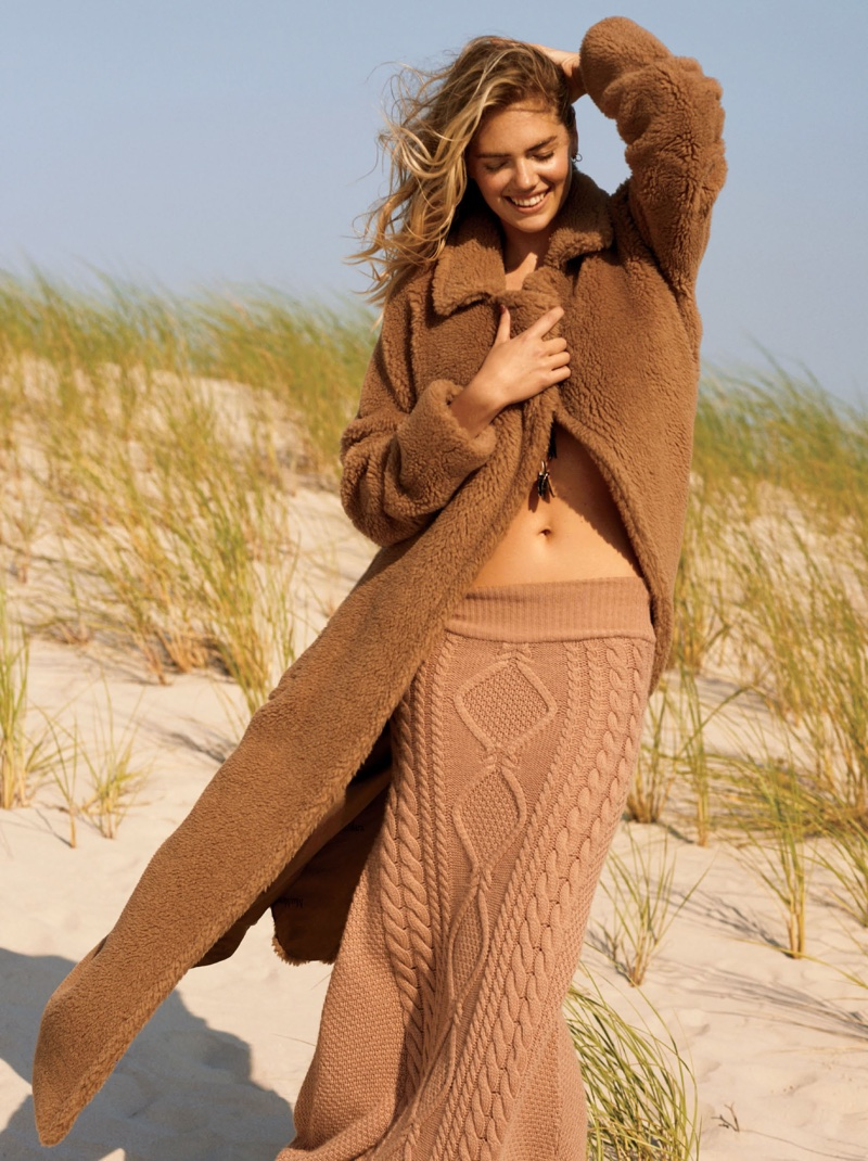 Kate Upton is all smiles in Max Mara coat with Ryan Roche skirt