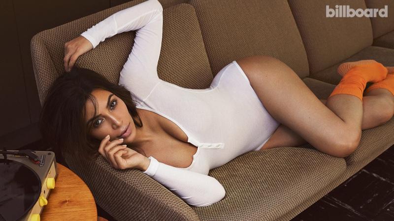 Kim Kardashian lounges in long-sleeve bodysuit