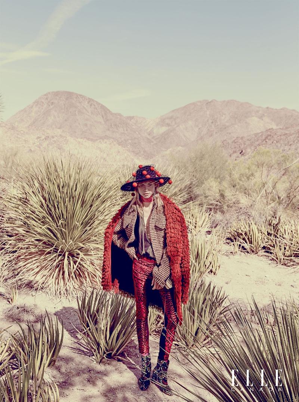 Laura Schellenberg poses in western inspired look with Philip Treacy hat