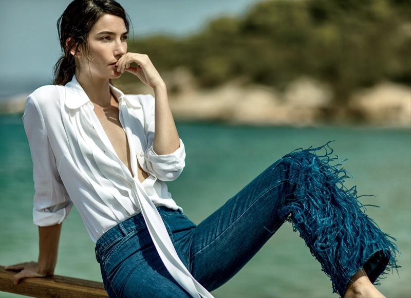 Lily Aldridge wears white blouse with frayed denim pants from Michael Kors