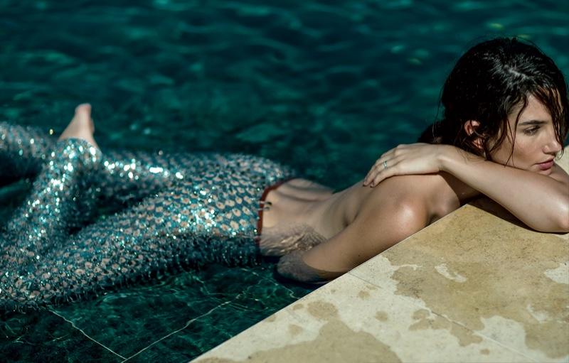 Posing in a pool, Lily Aldridge wears silver Michael Kors pants