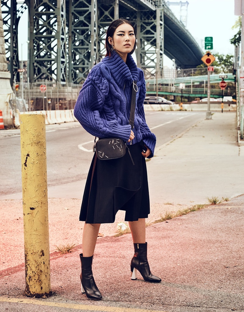 Liu Wen covers up in sweater by Off-White, skirt by Marni, boots by Jimmy Choo and Christopher Kane bag