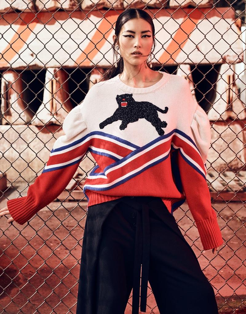 Liu Wen gets whimsical in Gucci sweater with pants by Proenza Schouler and Miu Miu earrings