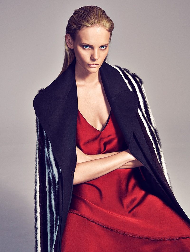Model wears Sportmax fur coat and red satin dress