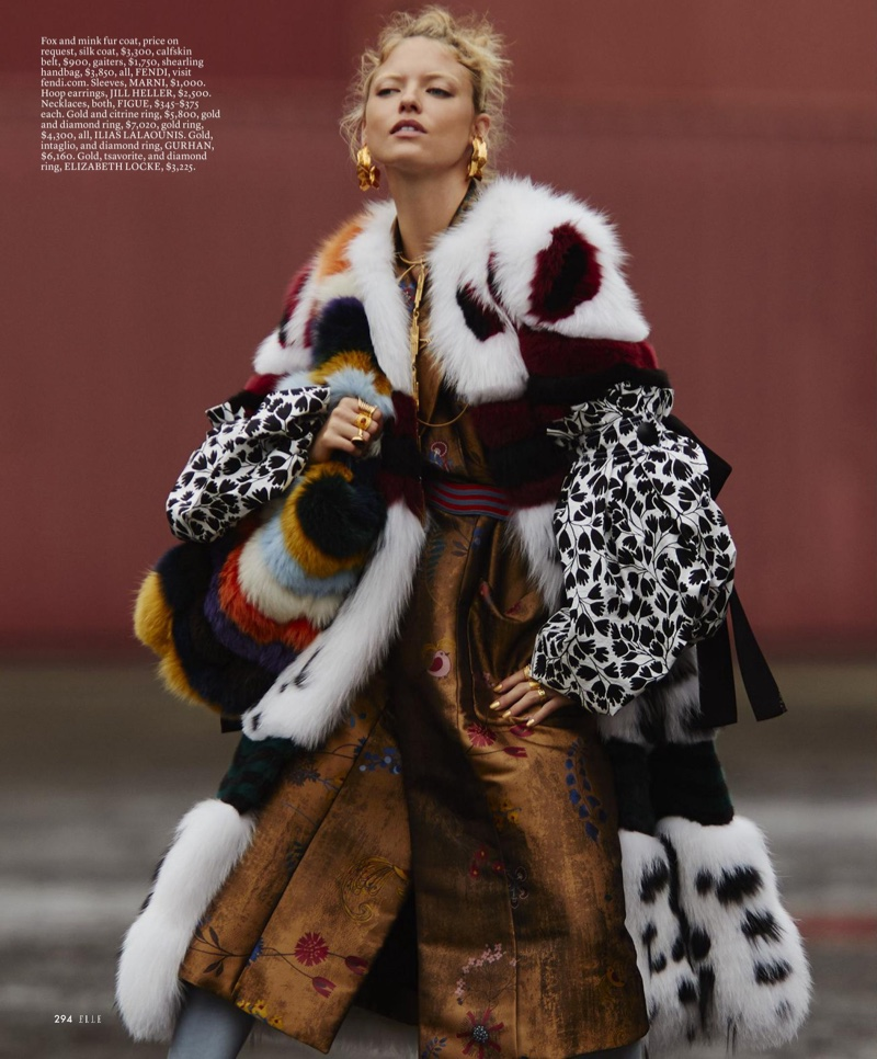Model Martha Hunt layers up in Fendi fur and silk coats with Marni sleeves