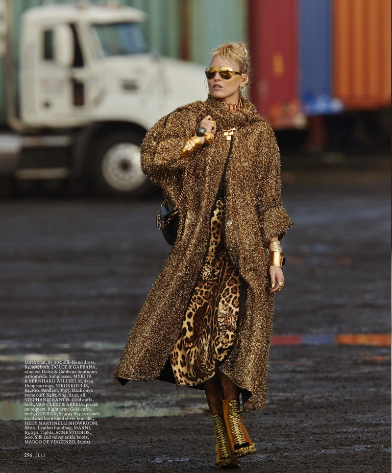 Martha Hunt wears lurex coat and animal print dress from Dolce & Gabbana with Marco de Vincenzo boots