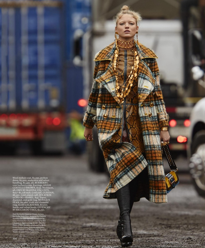 Martha Hunt takes a walk in wool mohair coat, dress and handbag from Burberry with Givenchy boots