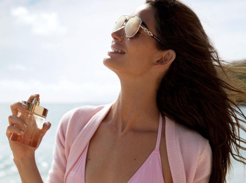 Lily Aldridge soaks up the sun behind the scenes on Michael Kors fragrance shoot