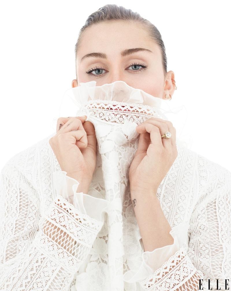 Miley Cyrus covers up in Giambattista Valli dress