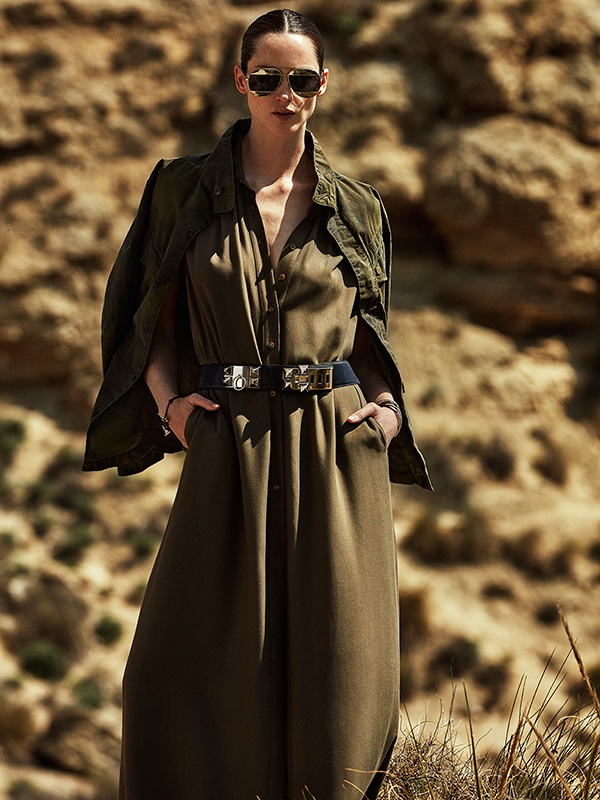 The model covers up in Adolfo Dominguez shirt dress dress, Hermes belt and G-Star jacket