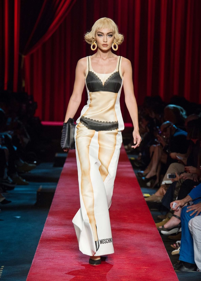 Moschino Spring 2017: Gigi Hadid walks the runway in dress featuring paper doll print with bra and underwear