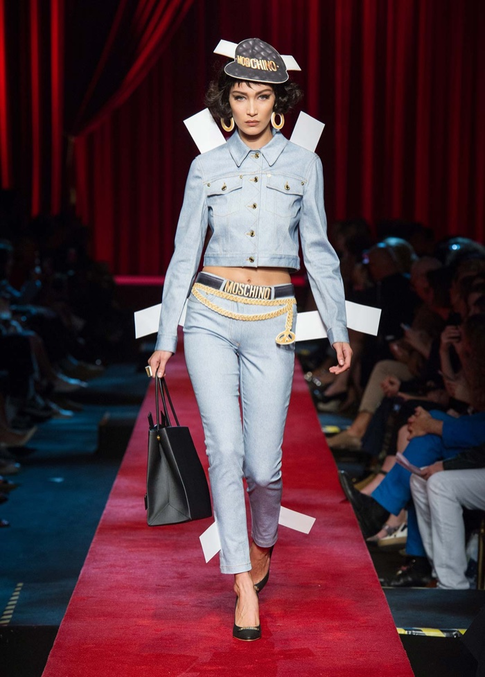 Moschino Spring 2017: Bella Hadid walks the runway in paper hat with light wash denim jacket and pants