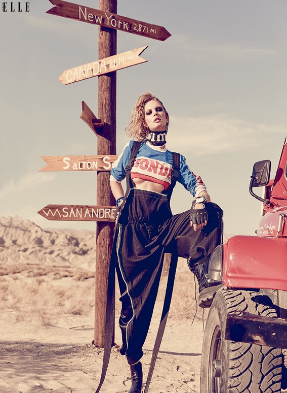 Posing in the desert, Patricia models Frankie Collective top with overall and boots from DKNY