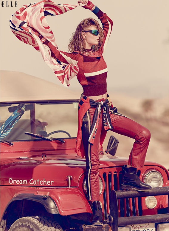 Patricia van der Vliet is a lady in red wearing Emilio Pucci sweater, Chloe pants and Hermes scarf
