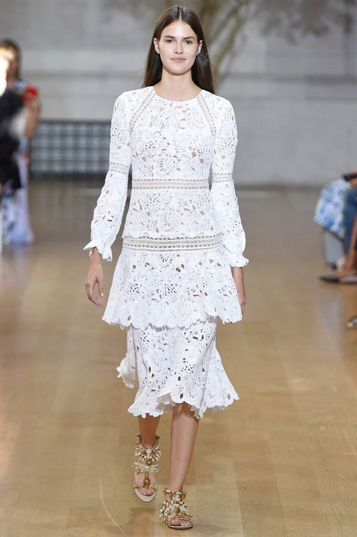 Oscar de la Renta Spring 2017: Model walks the runway in white crochet dress with tiered layers