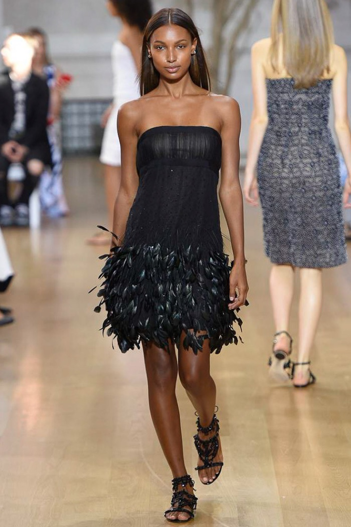 Oscar de la Renta Spring 2017: Jasmine Tookes walks the runway in black dress with feather trimmed hemline