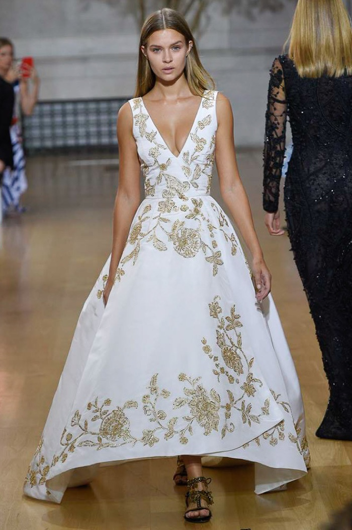 Oscar de la Renta Spring 2017: Josephine Skriver walks the runway in white gown with gold floral motif detail