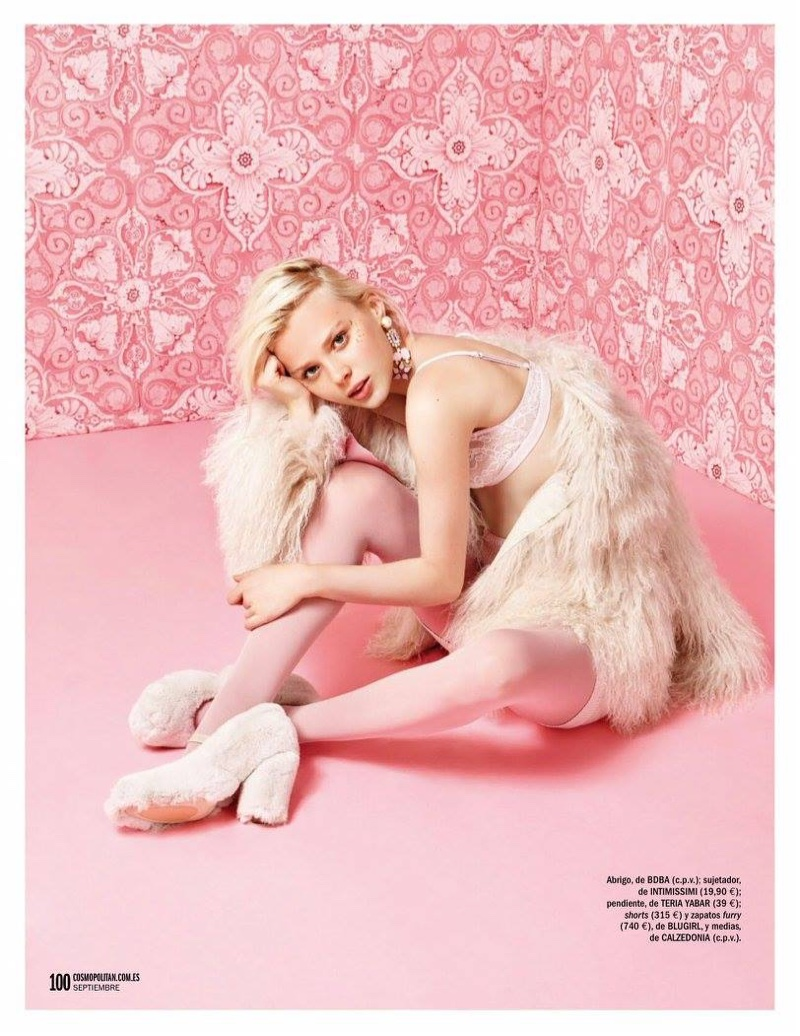 The model wears pastel fashions for the editorial