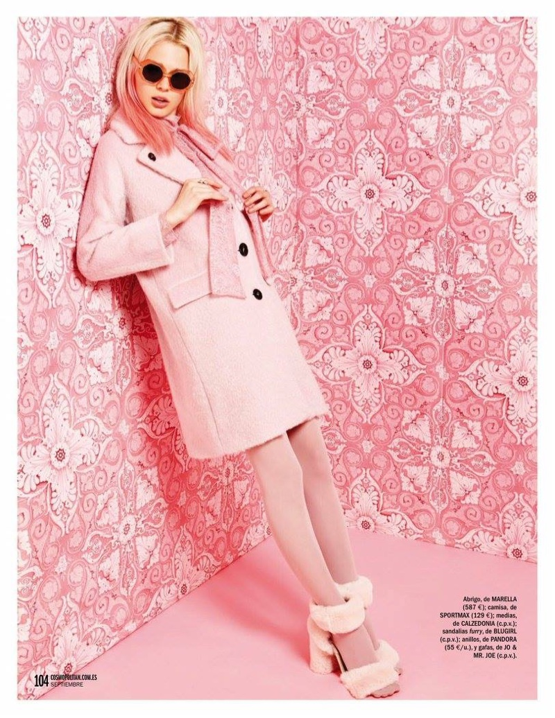 The model is mad for pastels in Marella jacket and furry platform sandals from Blugirl