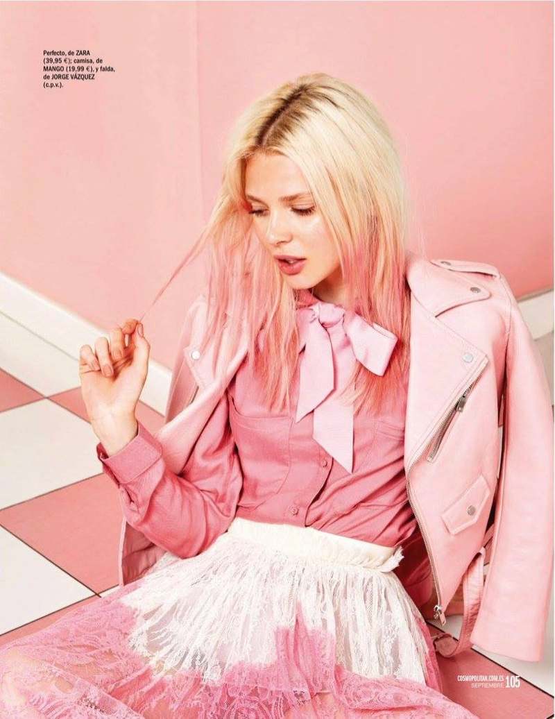 The model wears shades of pink including her pastel tinged hair