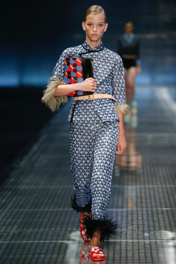 Prada Spring 2017: Model walks the runway in feather trimmed top and pants with geometric prints