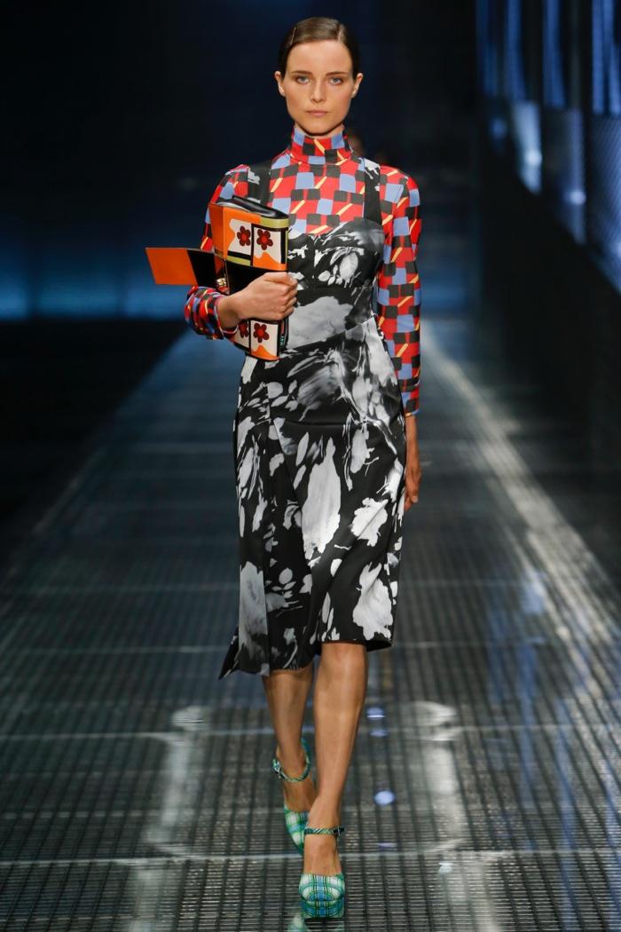 Prada Spring 2017: Model walks the runway in printed dress over turtleneck top