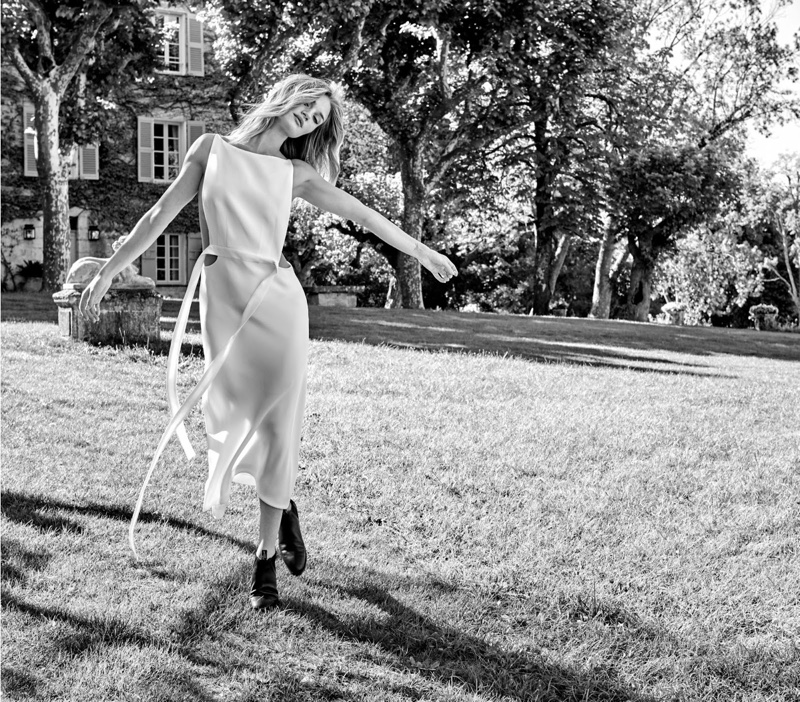 Posing outdoors, Rosie Huntington-Whiteley wears Karla Spetic dress with R.M. Williams boots