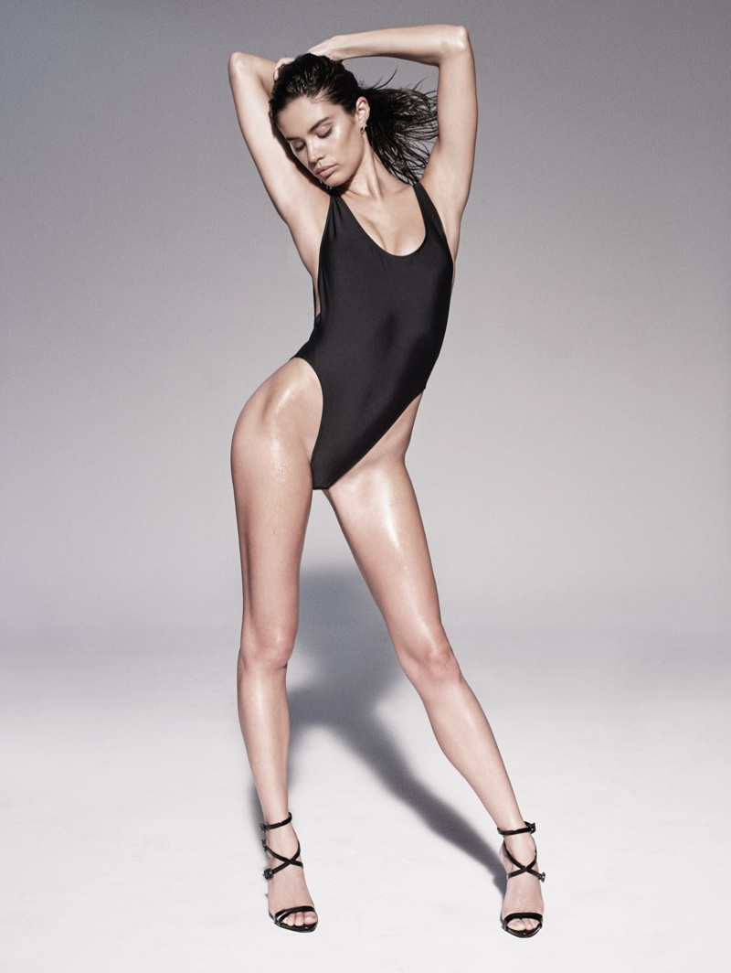 Sara Sampaio models black one-piece swimsuit