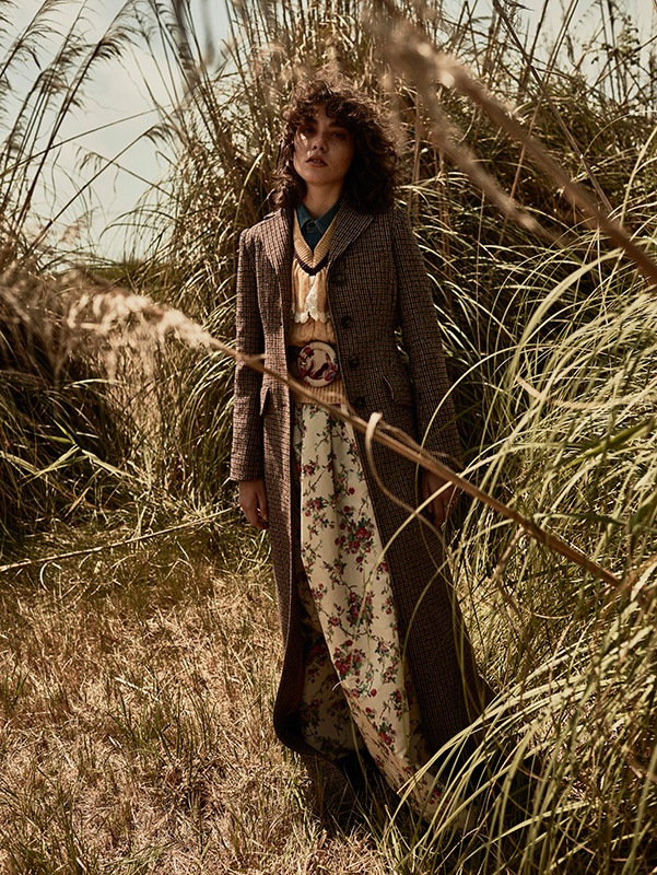 Photographed by Tomas de la Fuente, the model poses outdoors in the fall collections