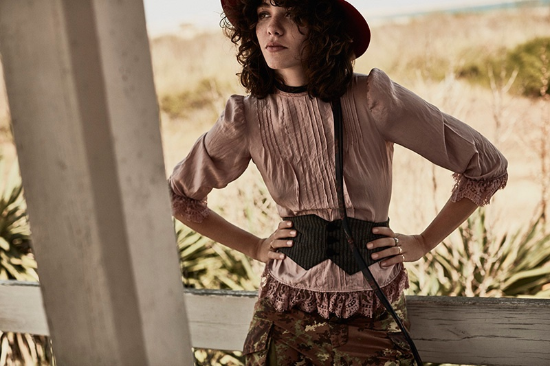 Steffy Argelich poses in Victorian inspired blouse and camouflage pants from DSquared2