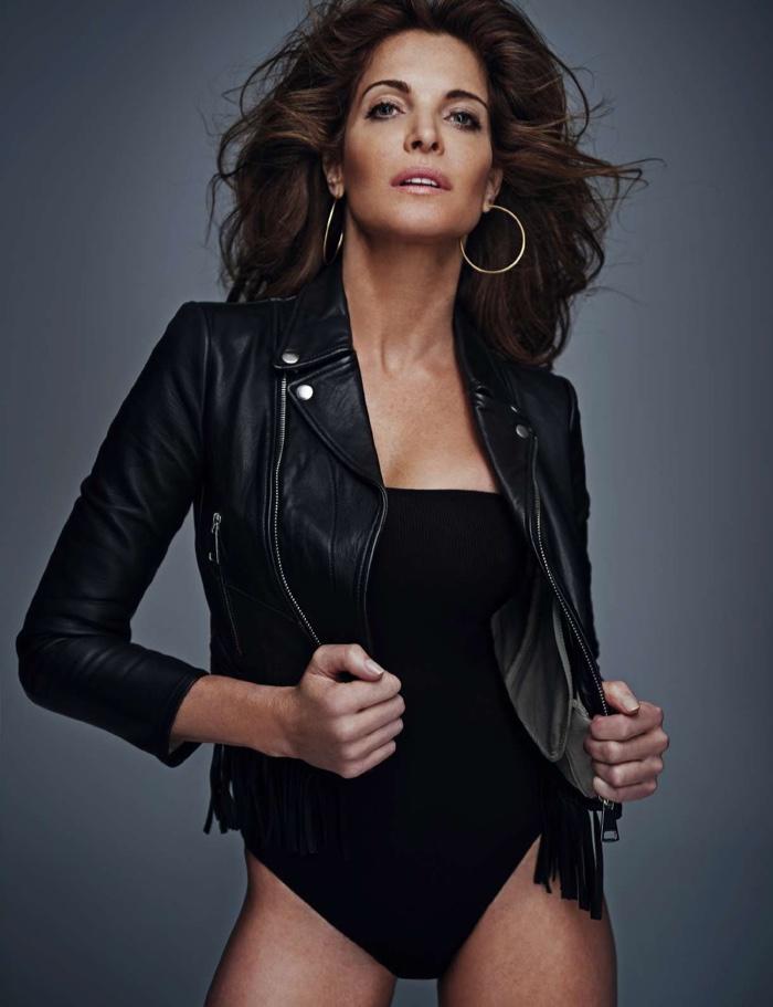 Stephanie Seymour wears leather jacket with strapless bodysuit