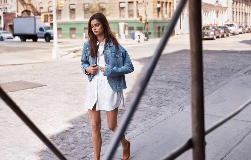 Taylor Hill wears Thakoon denim jacket over little white dress