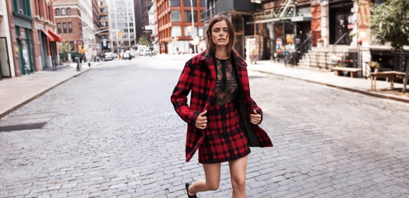 Taylor Hill models Thakoon buffalo plaid boucle coat and skirt with Chantilly lace top