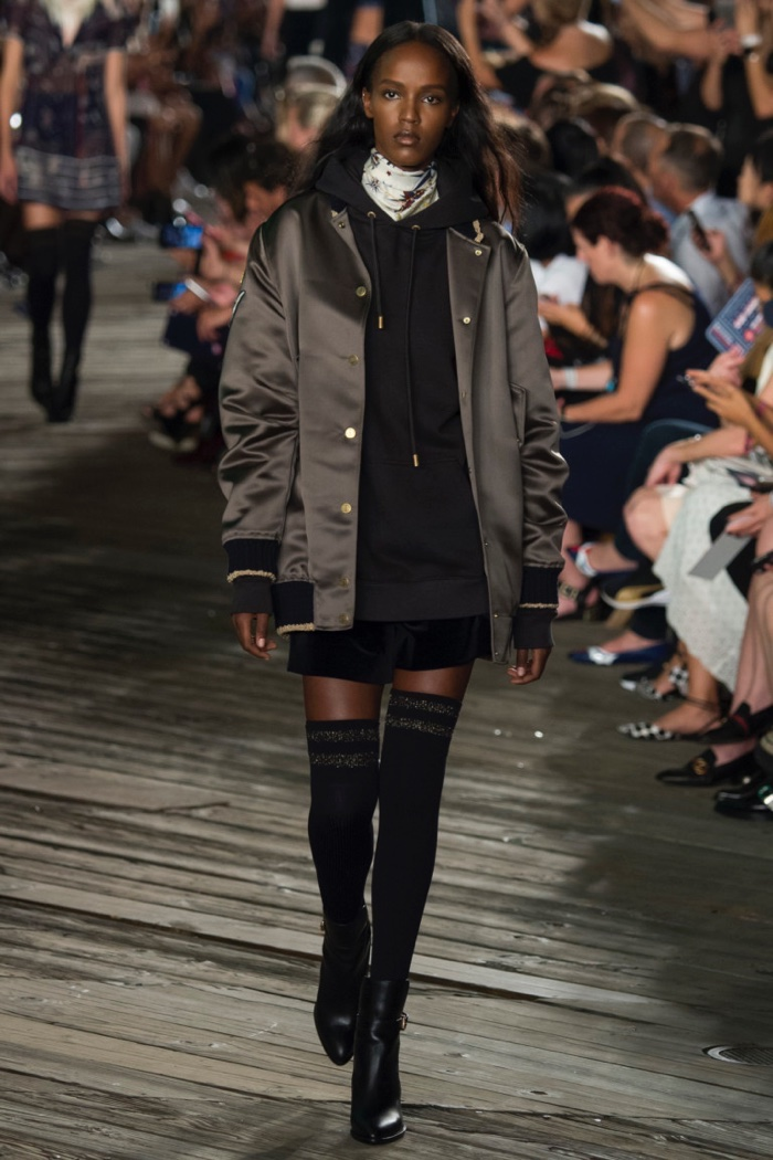 Tommy Hilfiger Fall 2016: Leila Nda walks the runway in bomber jacket, hooded sweatshirt, shorts, thigh-high stockings and ankle boots