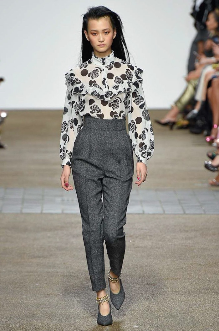 Topshop Unique Spring 2017: Wangy Xinyu walks the runway in floral print blouse with ruffles and high-waist trousers