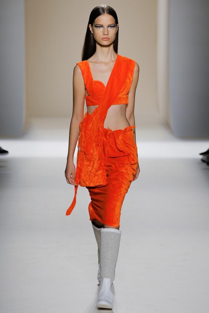 Victoria Beckham Spring 2017: Model walks the runway in orange velvet bralette and skirt