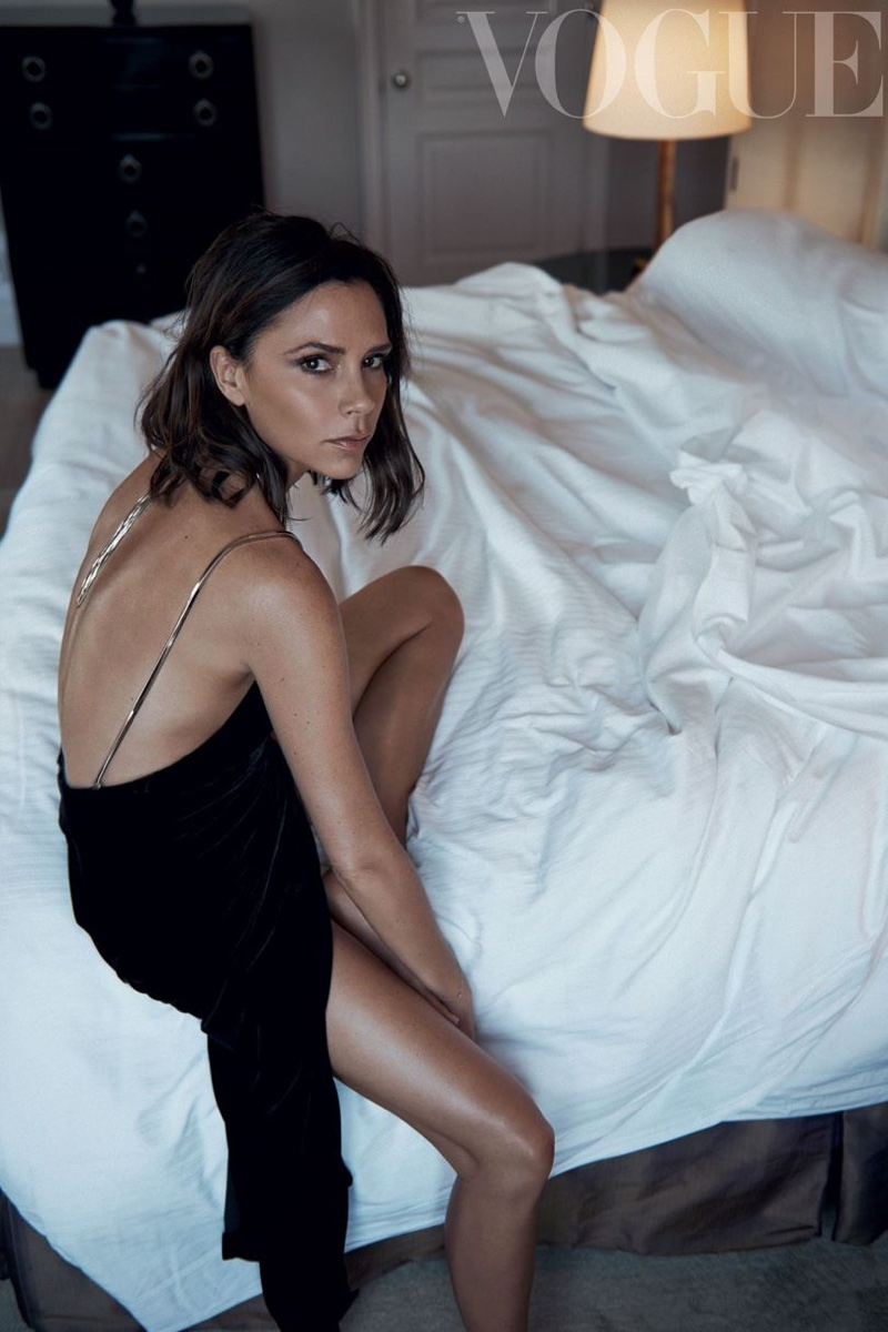 Victoria Beckham poses in bed wearing a slip dress