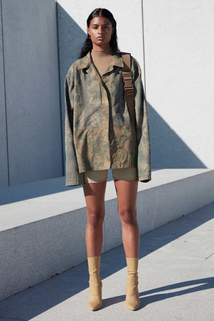 Yeezy Season 4: Camouflage printed jacket over shorts with calf-high boots