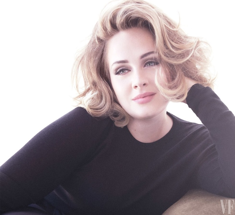 Adele poses in long-sleeve top