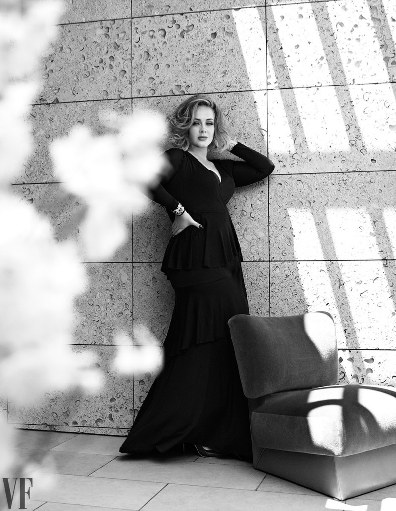 Photographed in black and white, Adele poses in tiered look