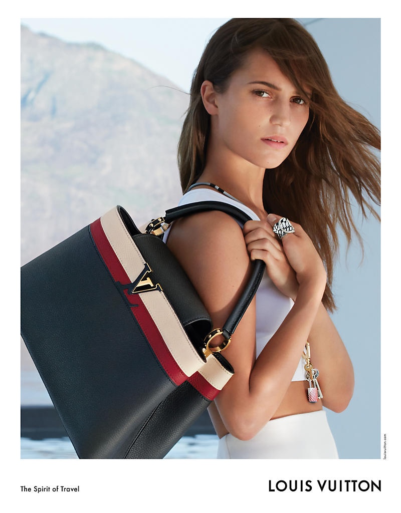Getting her closeup, Alicia Vikander poses with the Louis Vuitton Capucines MM bag