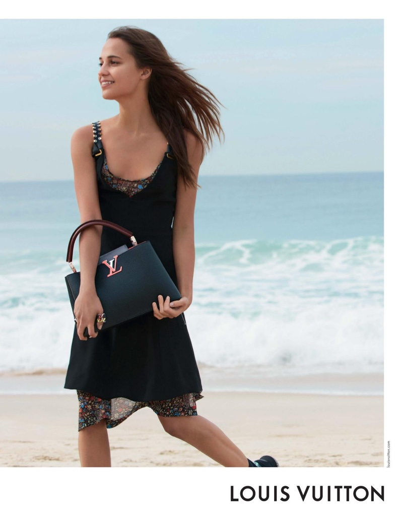 Alicia Vikander takes an all black look to the beach for Louis Vuitton's cruise 2017 Spirit of Travel campaign