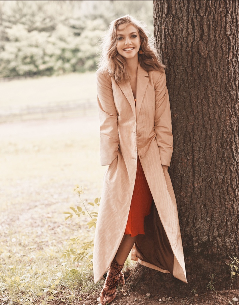 All smiles, Amanda Seyfried wears The Row coat and Eckhaus Latta dress
