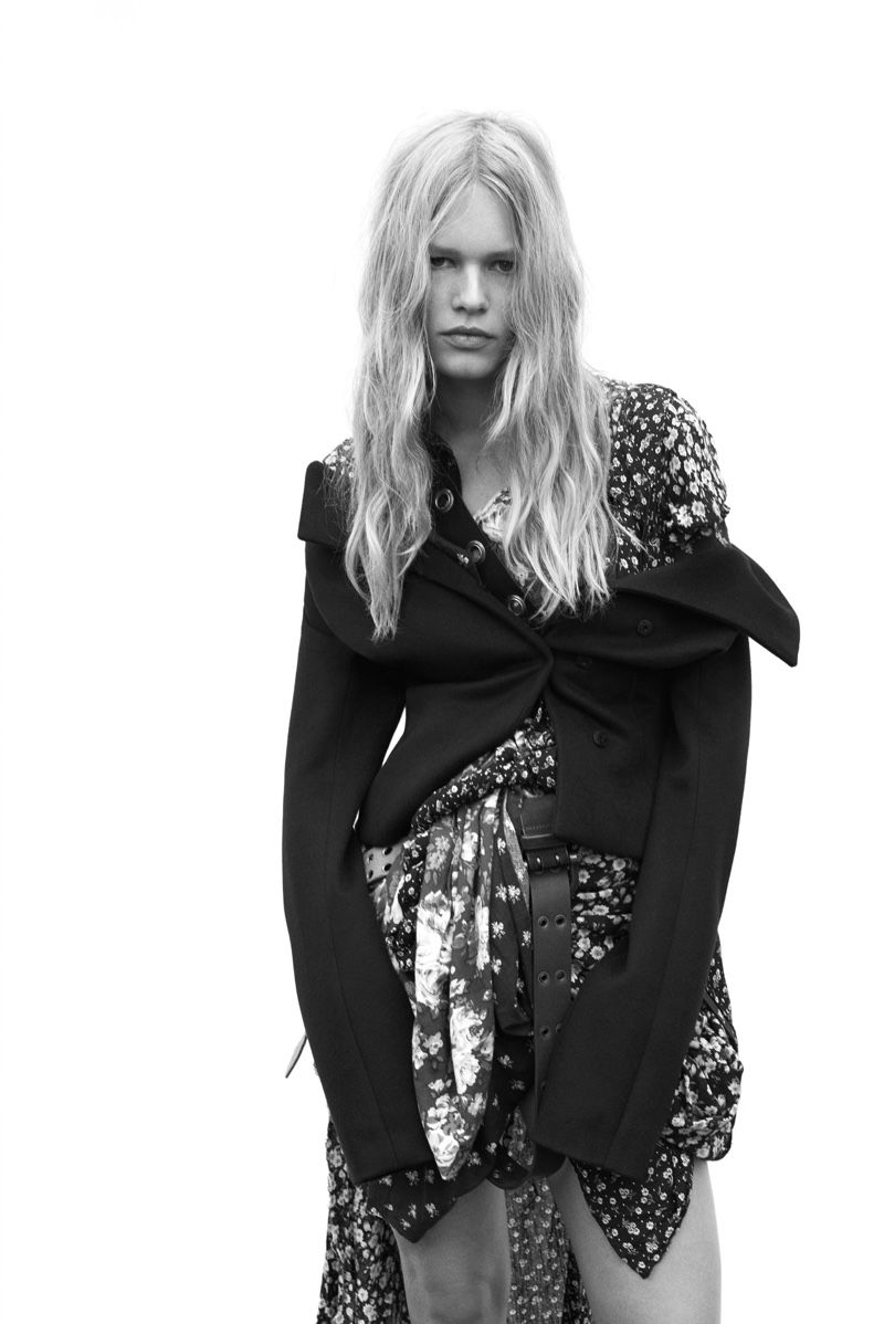 Photographed in black and white, Anna Ewers wears Dior jacket with stylist's own dress