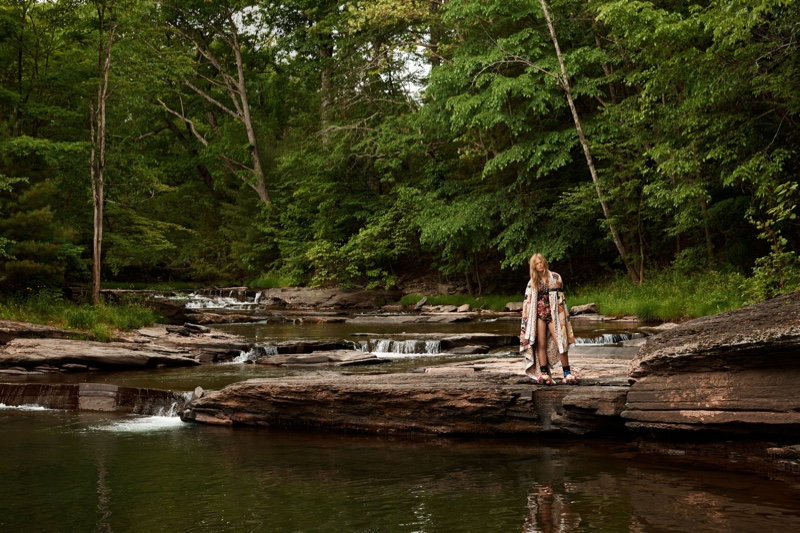 The model embraces the outdoor life in a patchwork blanket
