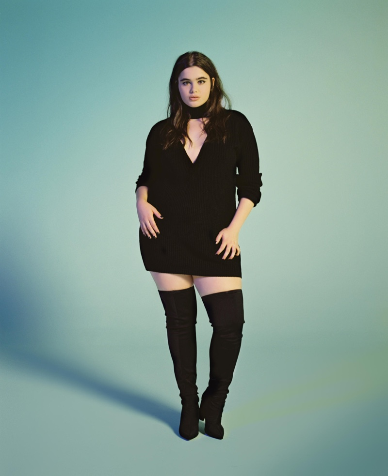 Wearing a little black dress, Barbie Ferreira poses in long-sleeve dress with thigh-high boots