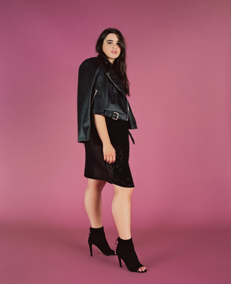 Plus size model Barbie Ferreira poses in leather jacket and black dress from Missguided+