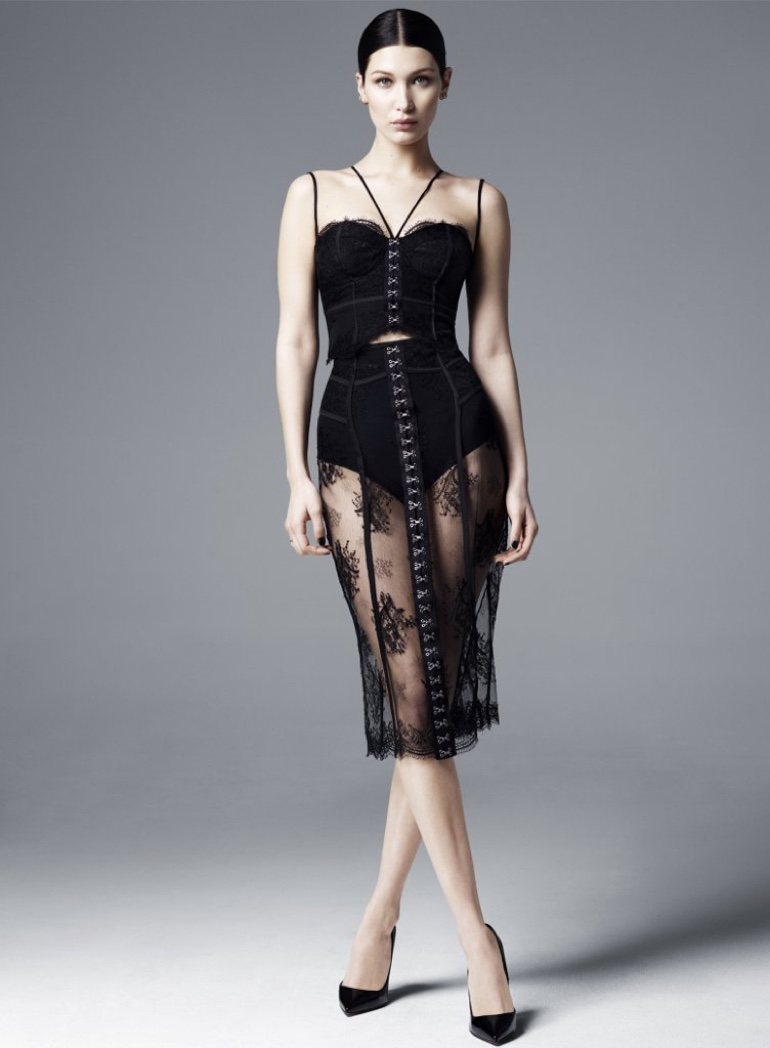 A form-fitting silhouette is embraced with Misha Gold's Skye lace bustier and Ivy lace skirt