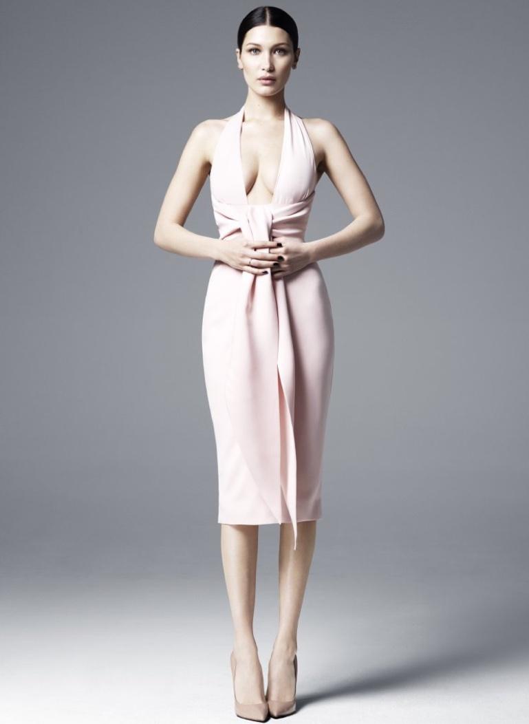 Wearing a plunging neckline, Bella Hadid wears Misha Gold Sian dress